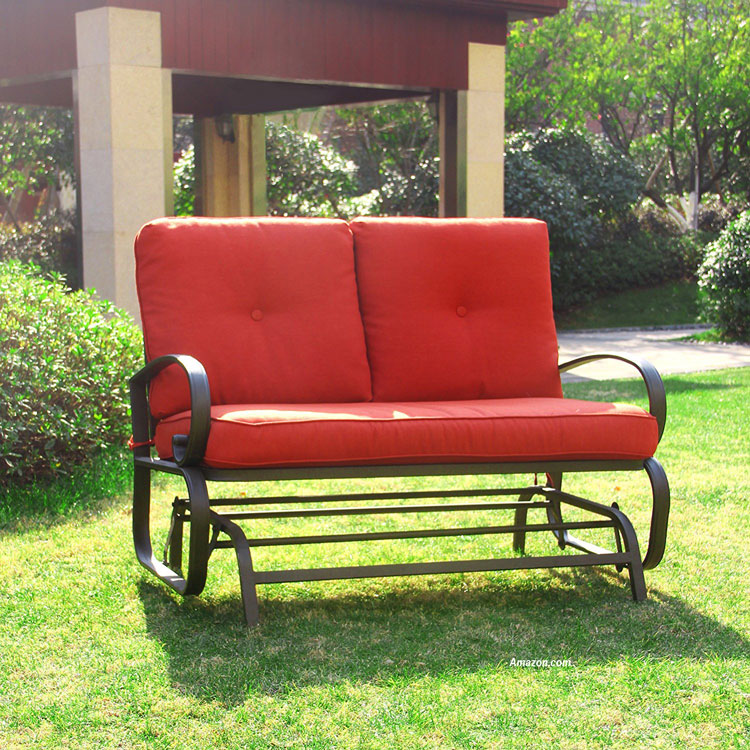 metal glider with orange cushions