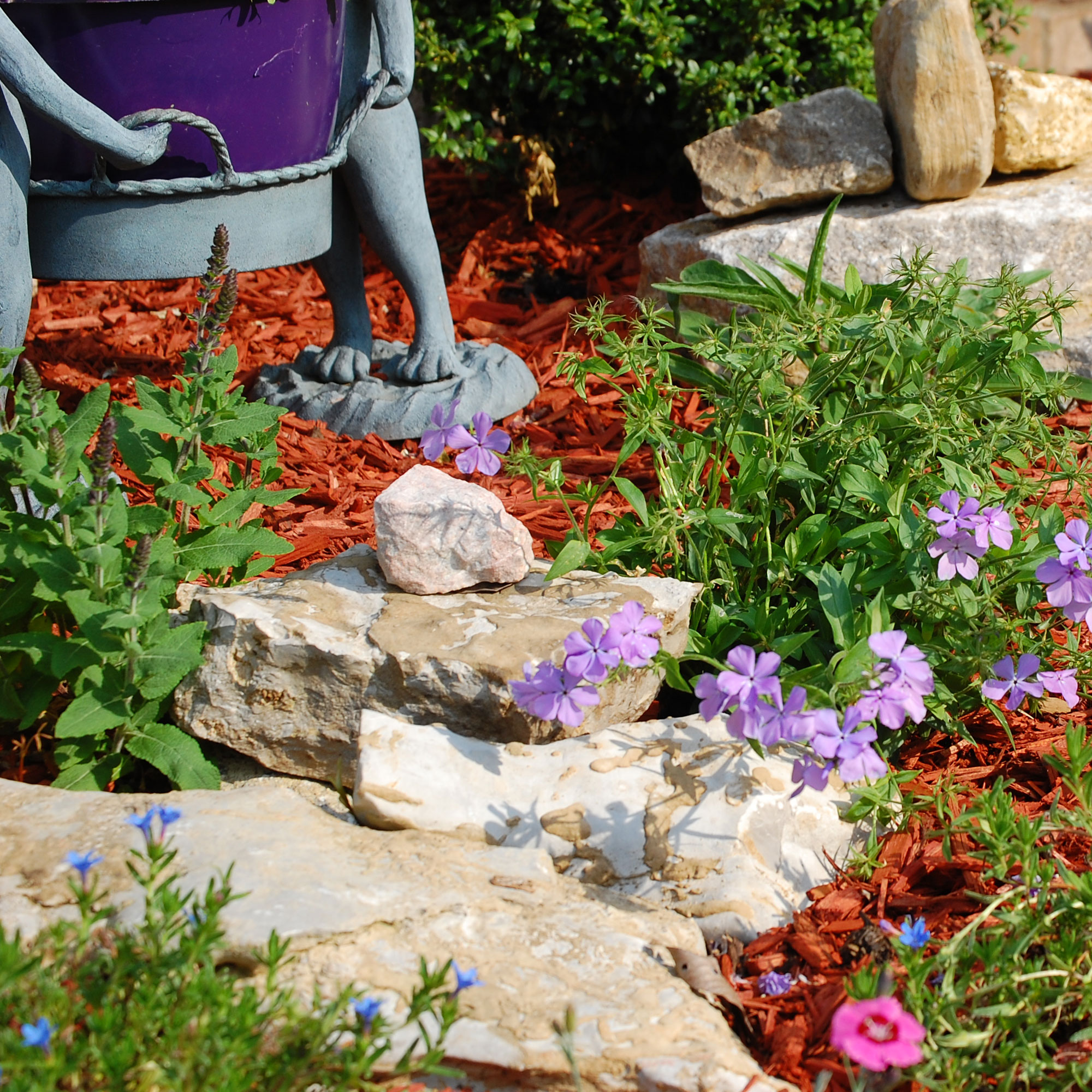 rocks strategically placed in flower garden in front of porch