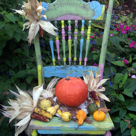 old chair painted in fall colors with gourds