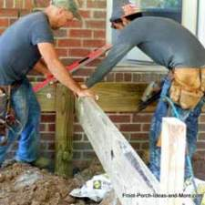 building contractors constructing porch