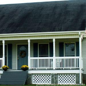 white custom vinyl lattice as porch skirting under front porch on home