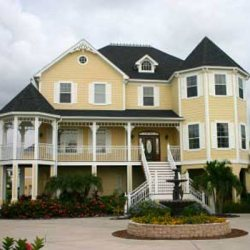 large yellow beach house and porch
