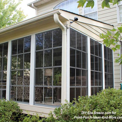 DIY eze-breeze windows installed on back porch to create a three-season room
