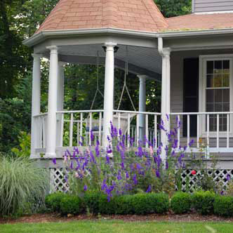 front porch landscaped with beautiful flowers