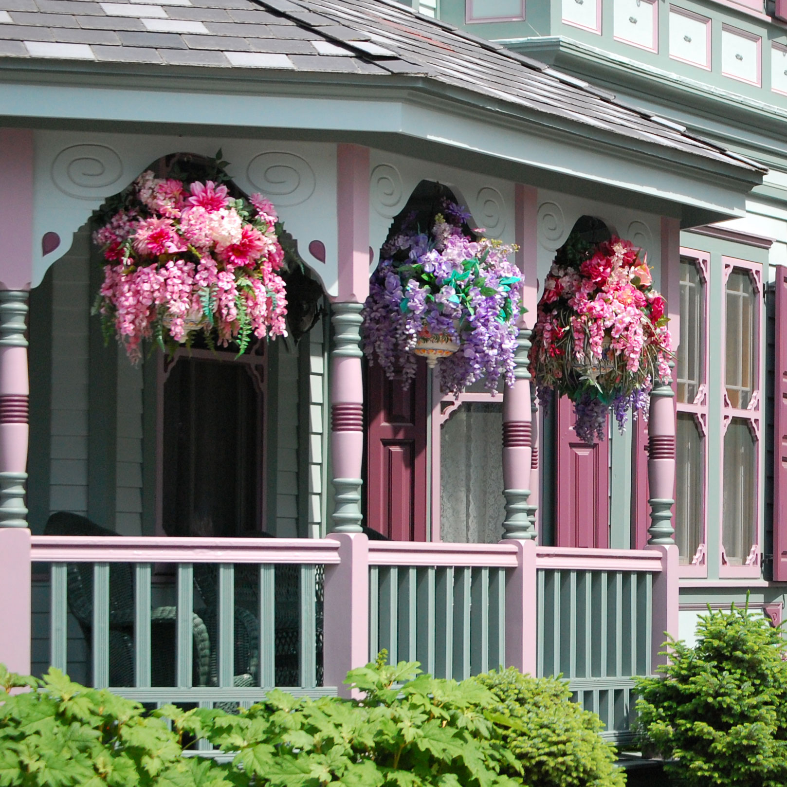 colorful Hanging Baskets on Victorian front porch