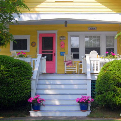 bright yellow painted house with great front porch