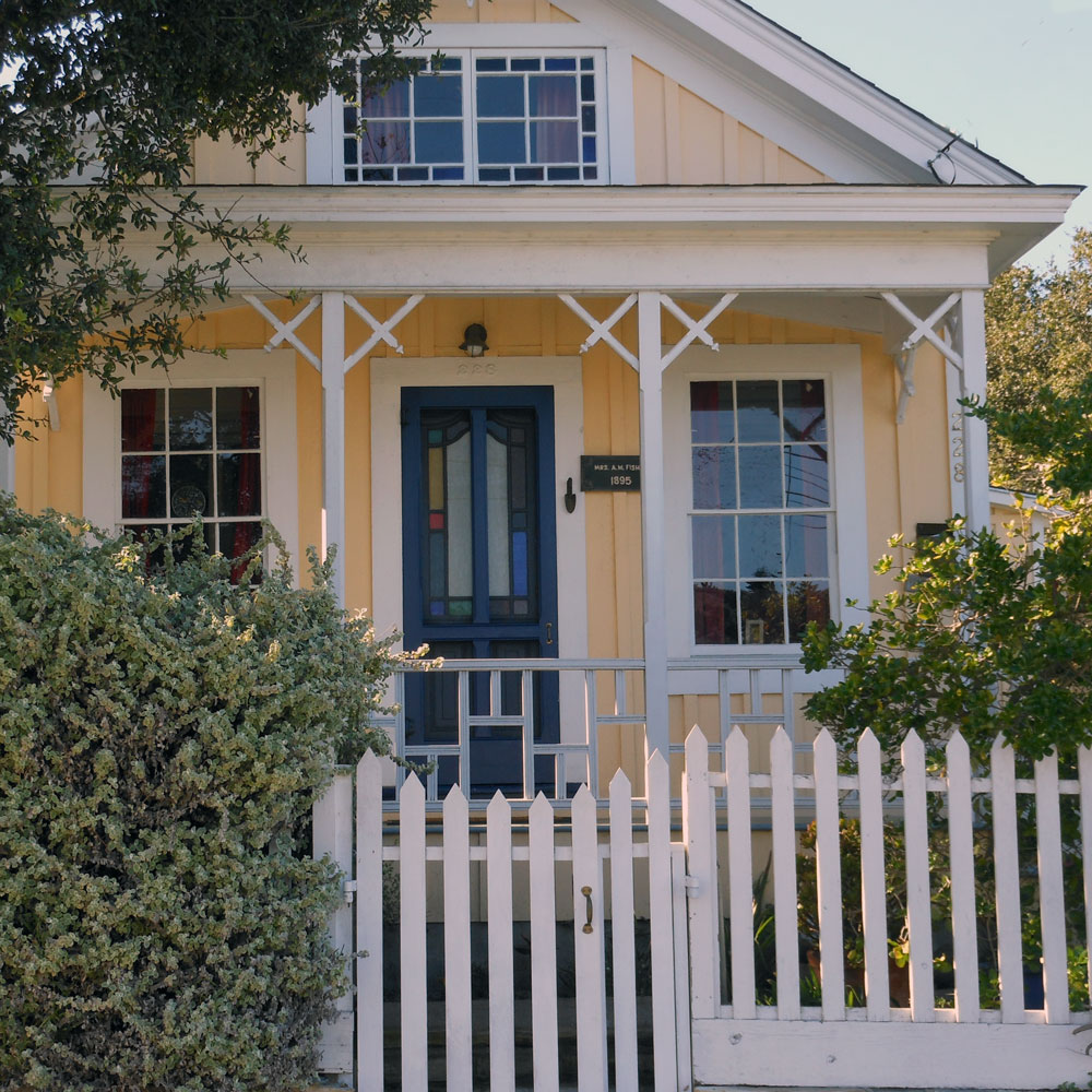 yellow house and porch with picket fence