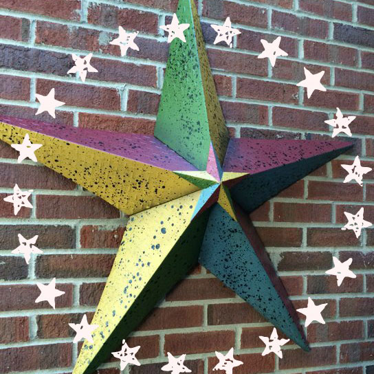 decorative star hanging on front porch wall