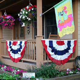 outdoor seasonal flag and Americana buntings on front porch