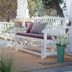 white outdoor furniture glider on front porch with cushions