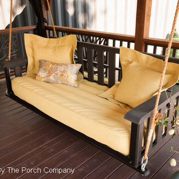 comfortable swing bed on front porch by The Porch Company