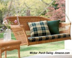 wicker porch swing with pillow