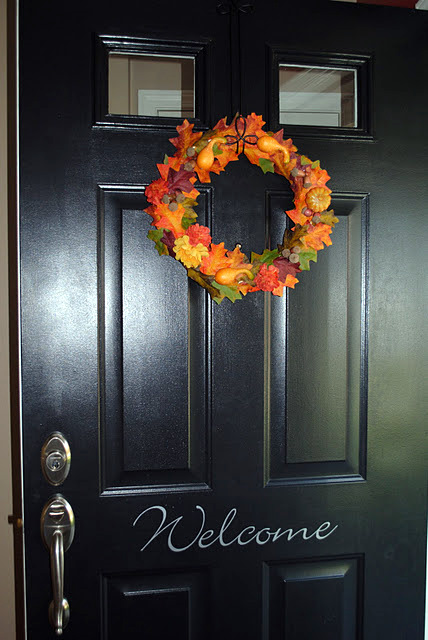 colorful autumn wreath on front door