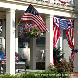 porch decorated for the 4th of July with flags and buntings