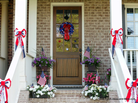 front porch decorated with red, white, and blue bows for the 4th of july