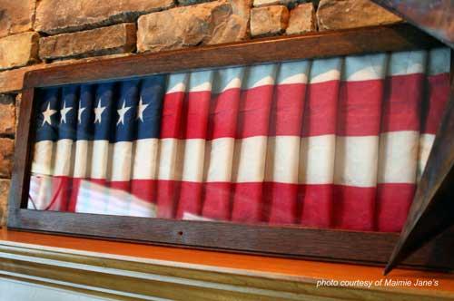 American flag inside oak frame
