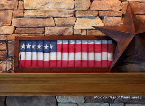 American flag in oak frame on mantel