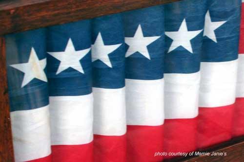 close-up of flag folded inside oak frame