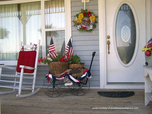 American flag display on cart on front porch