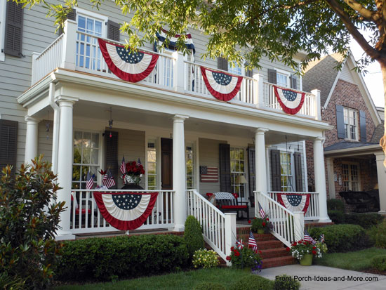 two story home decorated for the 4th of july