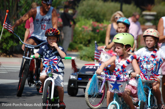 iconic 4th of july parade with kids on bikes