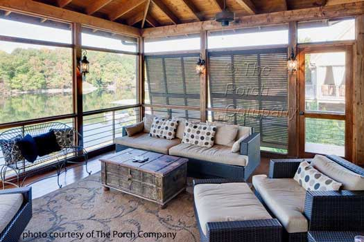 screen porch on lake with hurricane shutters