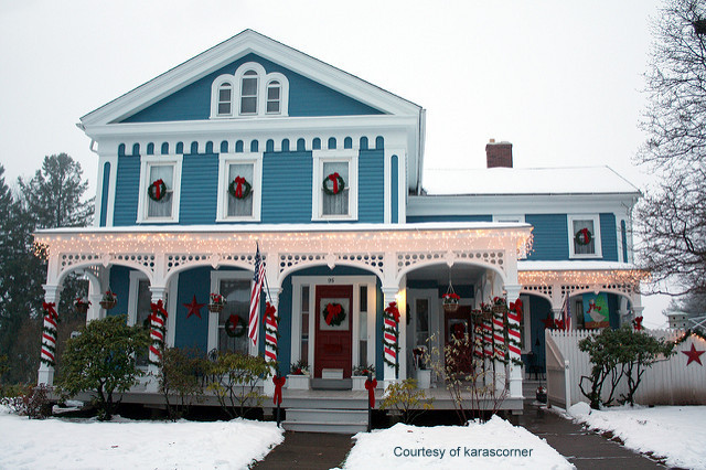Blue Victorian home decorated for Christmas