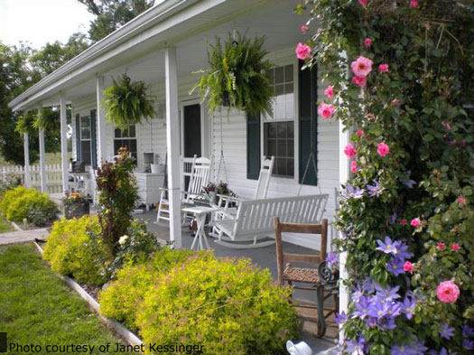 Country porches wrap around porches farm house for Landscape design around farmhouse front porch