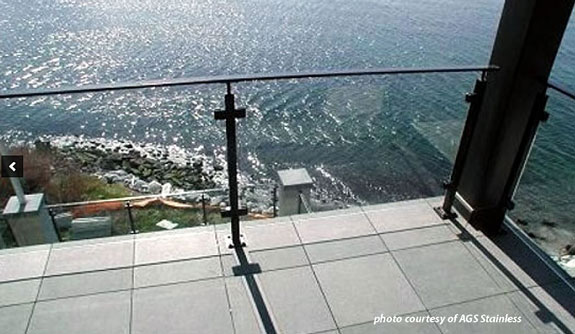 glass deck railings with view of ocean