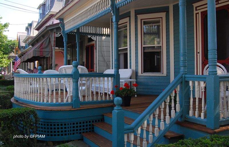 a blue front porch and porch extension