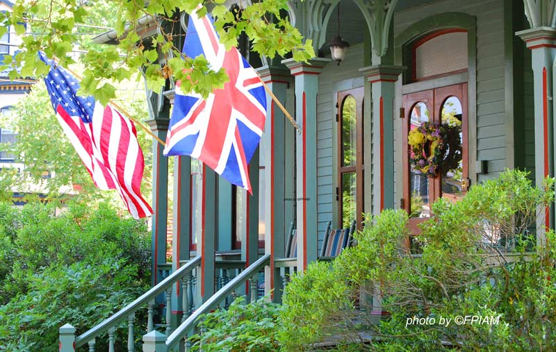Cape May NJ front porch with American and British flags