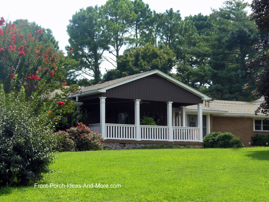 rather large gable roofed front porch on ranch style home