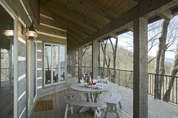 massive log porch with amazing view - photo courtesy of Roger Wade Studios
