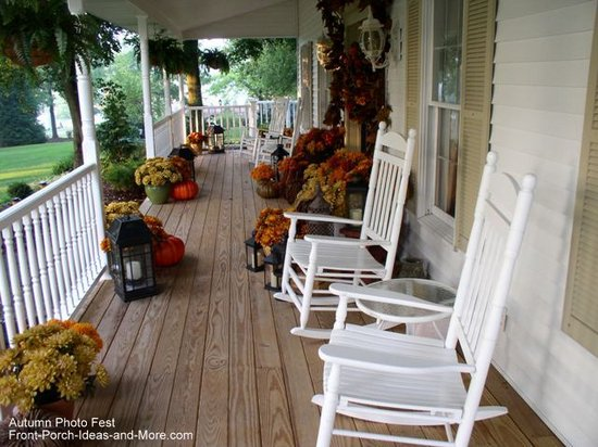 A beautiful country porch decorated for fall
