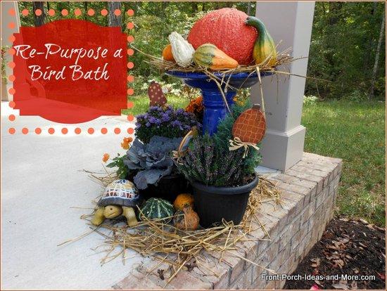 cobalt blue bird bath repurposed into an autumn harvest bonanza