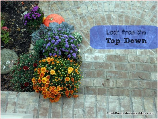 brick front porch steps decorated for fall