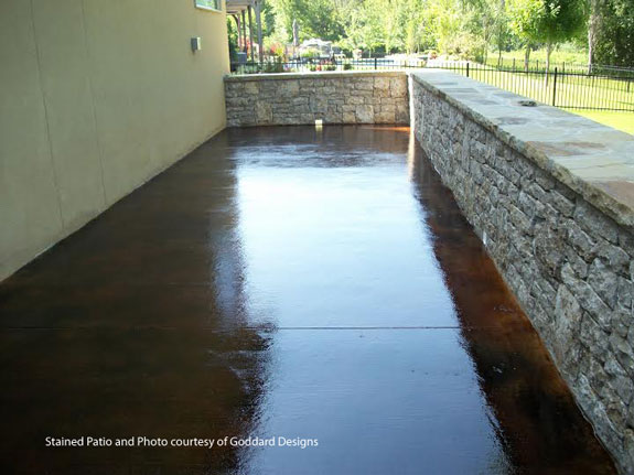 stained concrete patio by Goddard Designs
