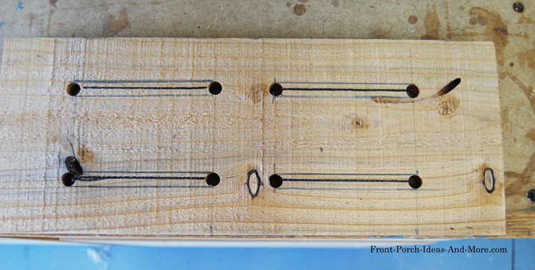 cedar fence slat marked for width of slots for butterfly house