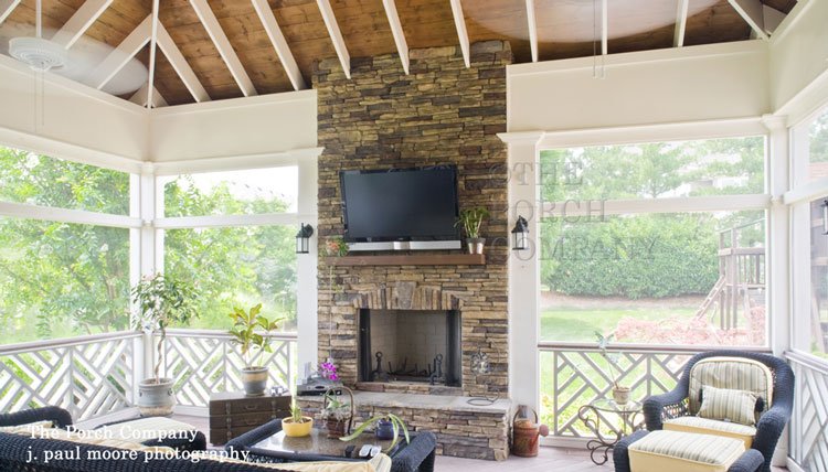 exposed white rafters along with stone fireplace - Screen Porch Design Ideas