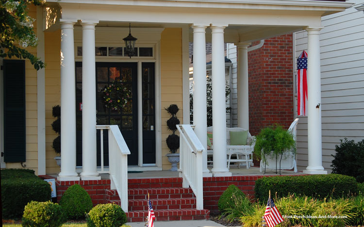 round tapered columns on wrap around porch
