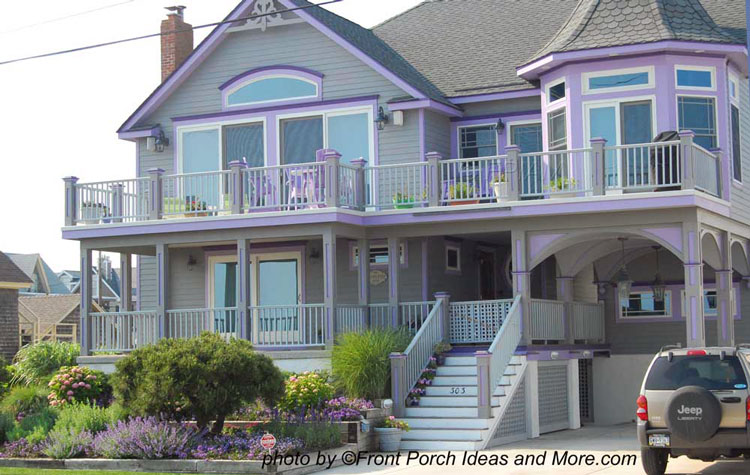 very colorful beach house and large front porch
