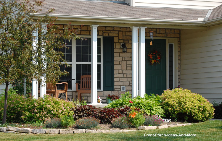nicely landscaped front porch