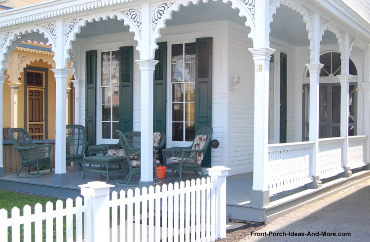 white Victorian front porch with ornate exterior house trim