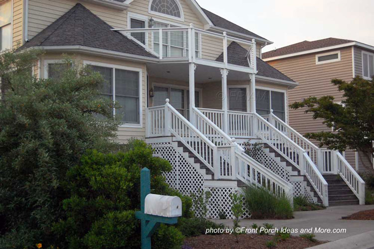 double front porch stair case on beach house design