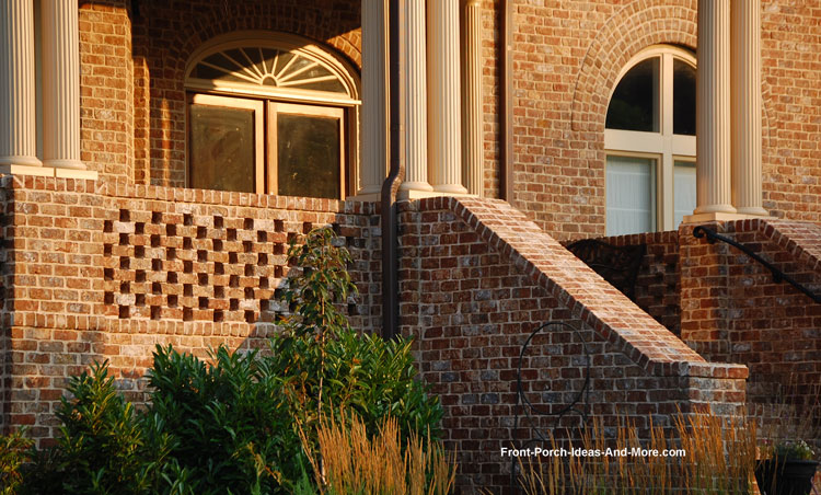 Wrought iron hand rail next to solid brick stair system