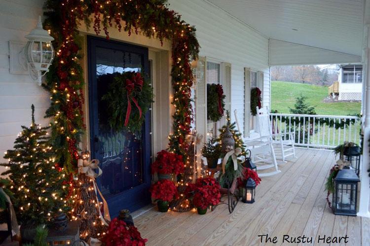 Christmas framed door with garland, lights, trees, lanterns