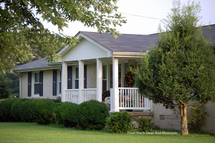 ranch home with gabled front porch