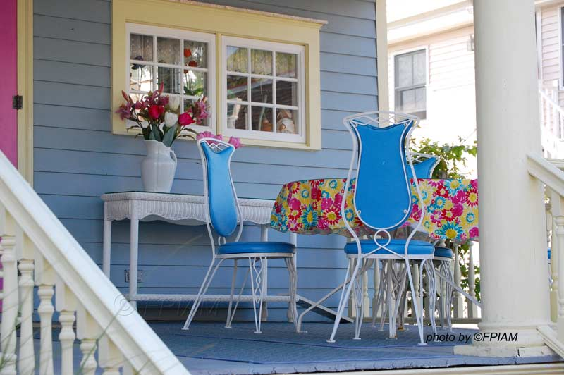 vintage bistro table and chairs on porch in Cape May NJ