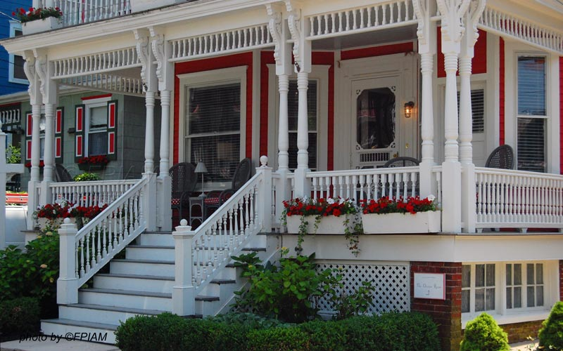 double porch turned columns on beautiful front porch