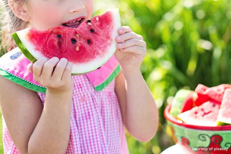 cute girl enjoying watermelon